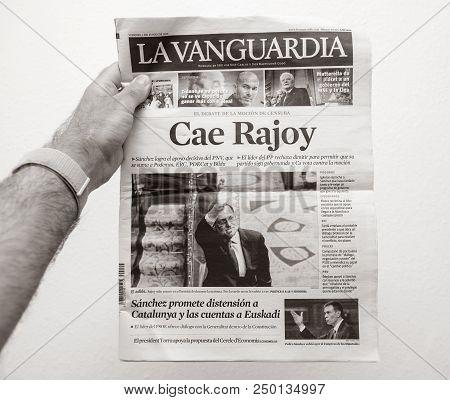 Barcelona, Spain - June 6 2018: Man Holding La Vanguardia Newspaper Cover With Cae Rajoy Translated