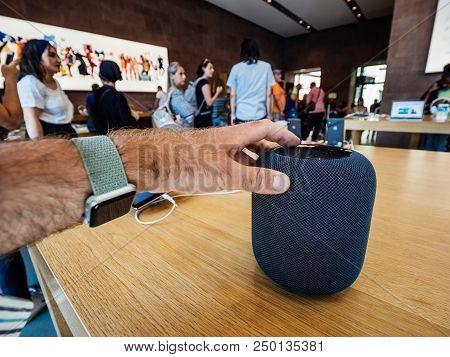 Paris, France - Jul 16, 2018: Man Touching Siri New Apple Store The Latest Apple Computers Homepod S