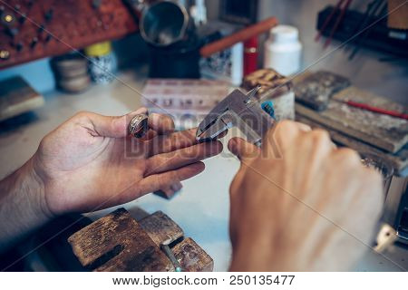 poster of Different goldsmiths tools on the jewelry workplace. Jeweler at work in jewelry. Desktop for craft jewelry making with professional tools. Close up view of tools.