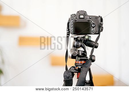 Professional Dslr Camera Standing On Tripod And Taking Interior Design Photos