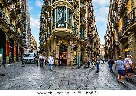 Barcelona, Spain - September 28, 2016: Tourists And Locals Start Their Day Early As Stores Open For
