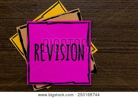Writing note showing Revision. Business photo showcasing Rechecking Before Proceeding Self Improvement Preparation Three art small paper two yellow one pink wood brown lite grey shadow poster
