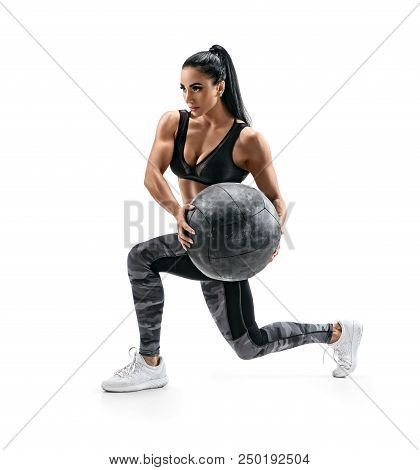 Muscular Woman Doing Lunge Twist Exercise With Med Ball. Photo Of Woman With Great Physique Isolated
