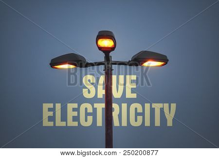 Closeup Of A Lamppost On The Street And Text Save Electricity