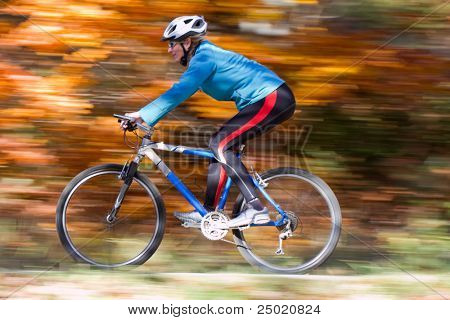 Mountain biking down the trail ( intentional motion blur)