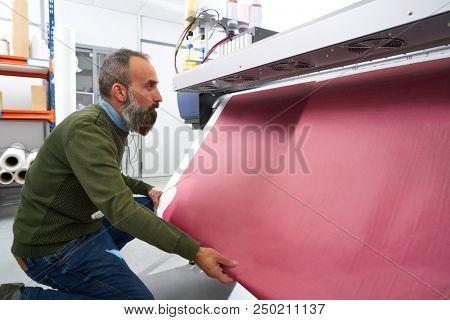 Expertise man in transfer printing industry plotter printer hipster beard