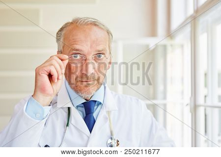 Senior doctor or physician as competent and successful surgeon