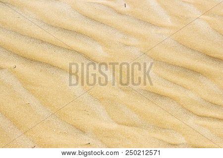 Wet Sand At Beach Coastline Texture Background.wave Form