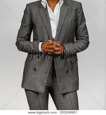 Cropped head of an African Business Woman in corporate suit clothing attire poster