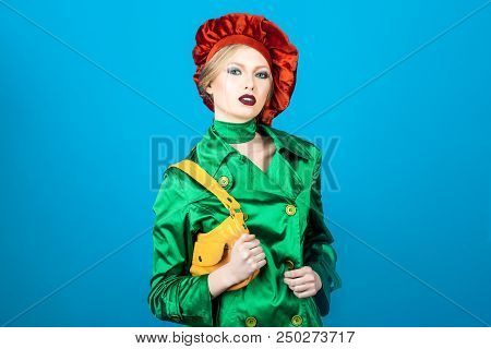Portrait Of Blonde Woman With Evening Makeup. Beauty And Fashion. Fashionable Girl In Green Suit And