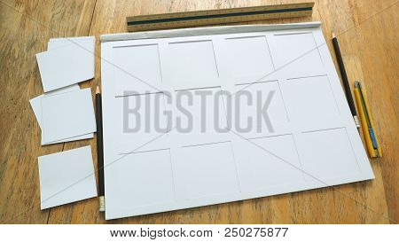 White paper frame 200gsm texture in book with stationary item and cutting rectangular has stationary are pencil, cutter ruler, scale ruler on the desk, Art work, homework, job concept. poster