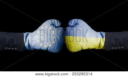 Boxing Gloves With European Union And Ukraine Flag. European Union Versus Ukraine Concept. Isolated