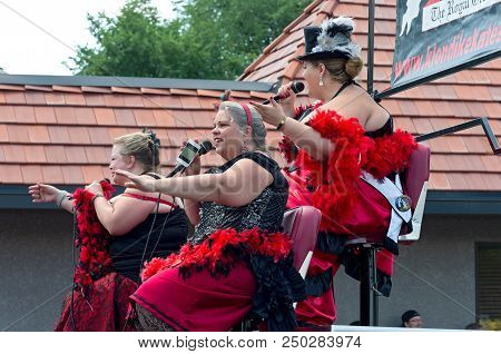 Mendota, Mn/usa - July 14, 2018: St. Paul Winter Carnival Royal Order Of Klondike Kates From Atop Fl