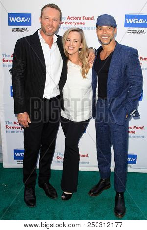 LOS ANGELES - JUN 11: Devon Gummersall, Devon Odessa, Wilson Cruz at The Actors Fund's 22nd Annual Tony Awards Viewing Party at the Skirball Cultural Center on June 10, 2018 in Los Angeles, CA