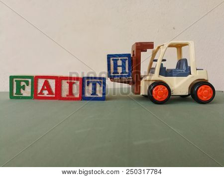 Toy forklift with faith wooden block