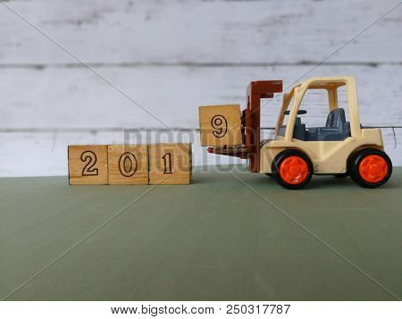 Toy forklift with 2019 wooden block