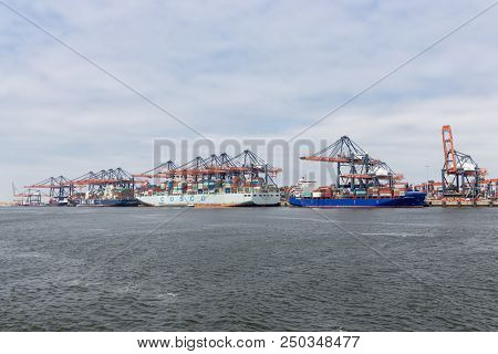 Rotterdam, The Netherlands - June 5 2018: Container Terminal In Dutch Harbor Rotterdam With Cargo Sh