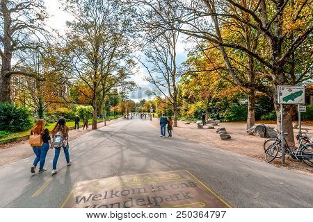 Amsterdam, Netherlands - October 1 2016: Tourists And Locals Enjoy An Afternoon At Vondelpark, The L