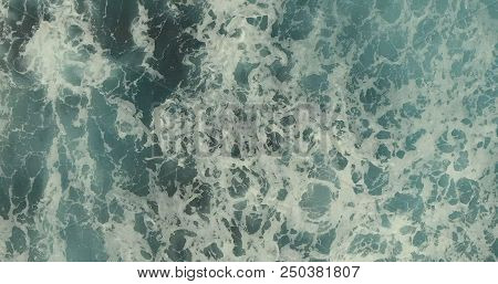 Aerial Photography. A Deep Blue Sea With Beautiful Waves Fascinates With Its Beauty.