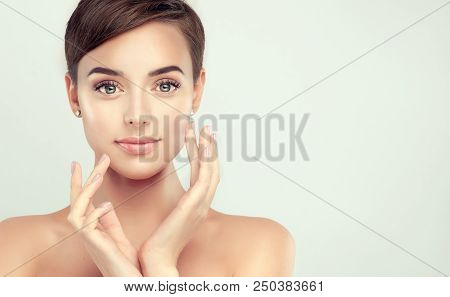 Beautiful Young Woman With Clean Fresh Skin. Face Care  . Facial  Treatment   . Cosmetology , Beauty
