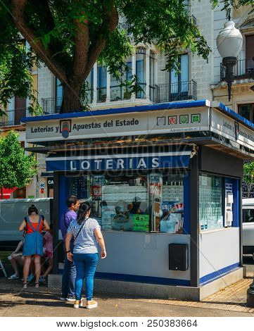 Tarragona, Spain - July 12, 2018: People Line Up To Purchase Lottery Tickets On A Stand On The Rambl