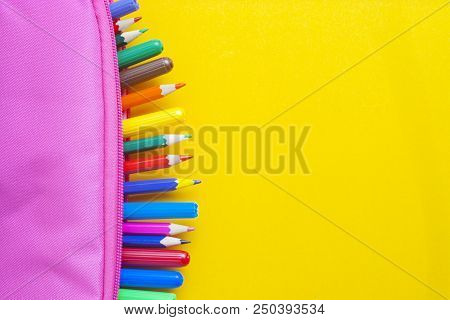Colourful Background. Colored Pencils School Supplies In Pink Case Yellow Background. Back To School