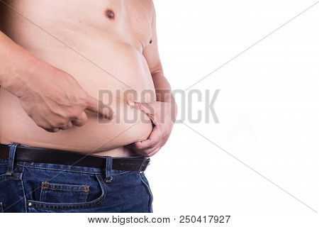 Man Pinching Own Unhealthy Big Belly With Visceral Or Subcutaneous Fats. Pose Health Risk.