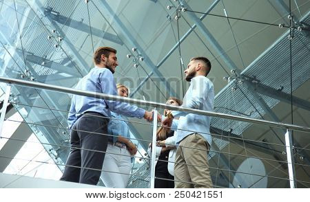Bottom View. Business People Shaking Hands, Finishing Up A Meeting