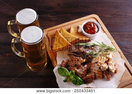 Beer Snacks, Meat Assortment, Pub Food. Various Kinds Of Roasted Meats With Hot Sauce, Toasts And Be