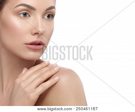 Pretty Girl With Perfect Face Features Touching Her Shoulder, Posing On White Studio Background. Hav
