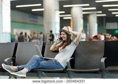 Young Laughing Traveler Tourist Woman Working On Laptop, Talk On Mobile Phone, Call Friend, Booking