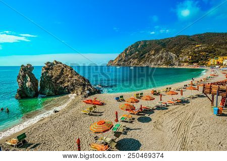Chairs And Umbrellas Fill The Spiaggia Di Fegina, The Wide Sandy Beach In Front Of The Old Section O