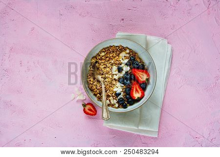 Healthy Muesli With Fresh Berries On Pink Copy Space Background. Superfood And Detox Concept. Flat L