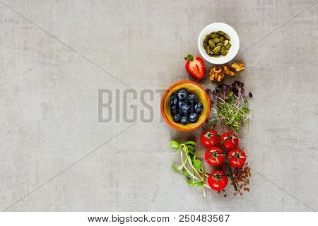 Flat-lay Of Clean Eating Healthy Food Selection. Micro Greens, Nuts, Seeds, Superfood, Berry, Tomato