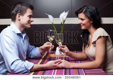 Young Couple Drinking Wine And Flirting