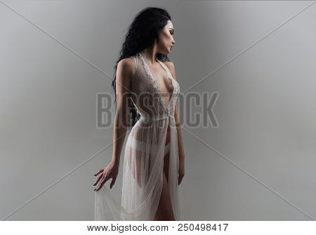 Sensual Girl. Sensual Girl In White Dress. Sensual Girl In Fashionable Dressing Gown. Girl With Sens