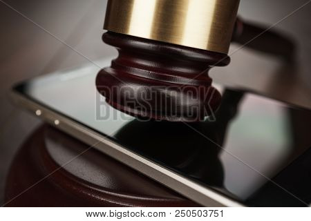 Judge Gavel On A Smart Phone Concept