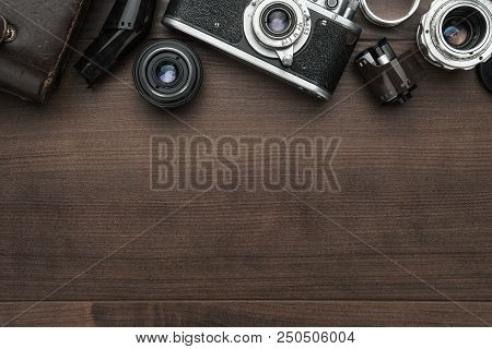Retro Film Photography Camera And Some Lenses. Photography Accessories On The Brown Table. Photo Of
