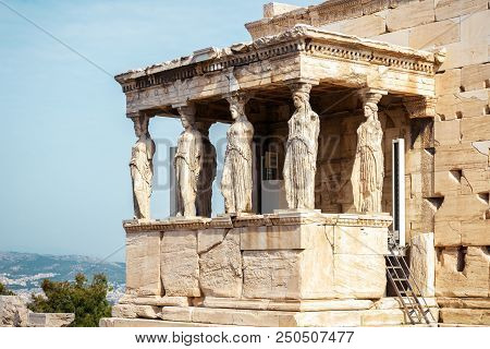 Caryatid Porch of Erechtheion on the Acropolis in Athens, Greece. Famous architectural detail with the beautiful women's figures. Acropolis with Ancient Greek temples is the main landmark of Athens. poster