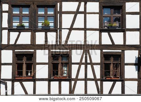 Wall And Windows Of Traditional Old House In Strasbourg, France