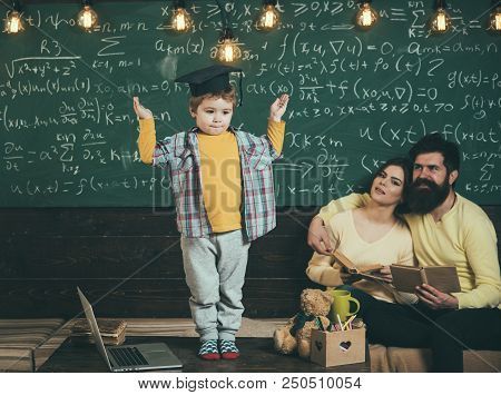 Schoolboy Answer Lesson At Chalkboard. Little Schoolboy In Graduation Cap. Schoolboy And Family In C