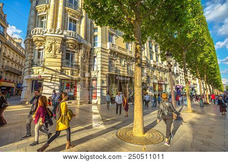 Paris, France - July 2, 2017: People Walk On The Most Famous Avenue In Paris Champs Elysees, Known F
