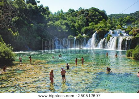 Skradin, Croatia - July 8, 2018: Tourists Bathing In A Waterfall In Krka National Park At Skradin Ci
