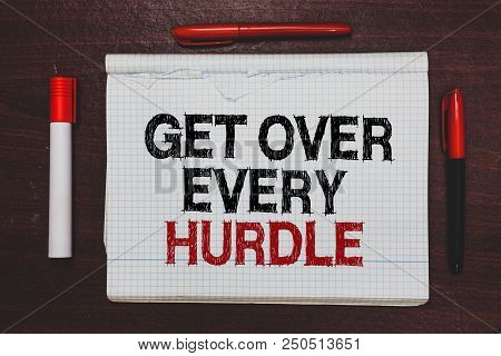 Handwriting text writing Get Over Every Hurdle. Concept meaning Overcome any obstacle problem trouble adversities Written black, red words notepad on brown stage white highlighter red pens poster