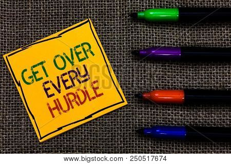 Conceptual hand writing showing Get Over Every Hurdle. Business photo text Overcome any obstacle problem trouble adversities Written on black lined yellow transverse note pen jute ground poster