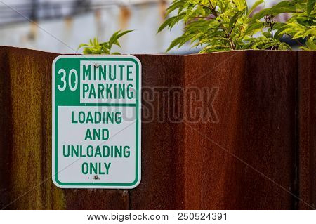 Old Faded Worn Metal 30 Minute Parking Sign With Green Text On White