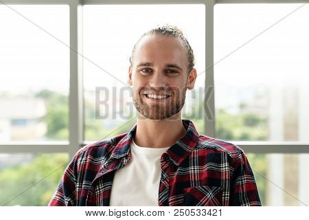 Portrait Of Young Happy Short Stylish Bearded Caucasian Man Or Creative Designer Smiling And Looking