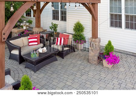 Comfortable Chairs With Colorful Red Cushions On An Outdoor Brick Patio Covered By A Wooden Gazebo I