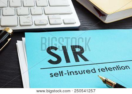 Self-insured retention SIR insurance on a desk. poster