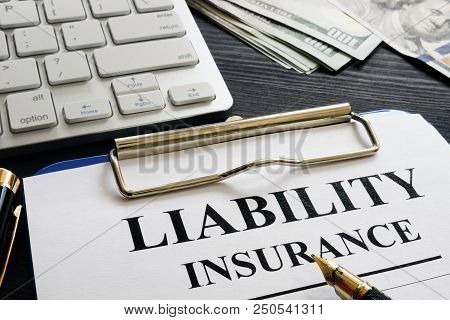 Liability Insurance Agreement Policy On The Desk.